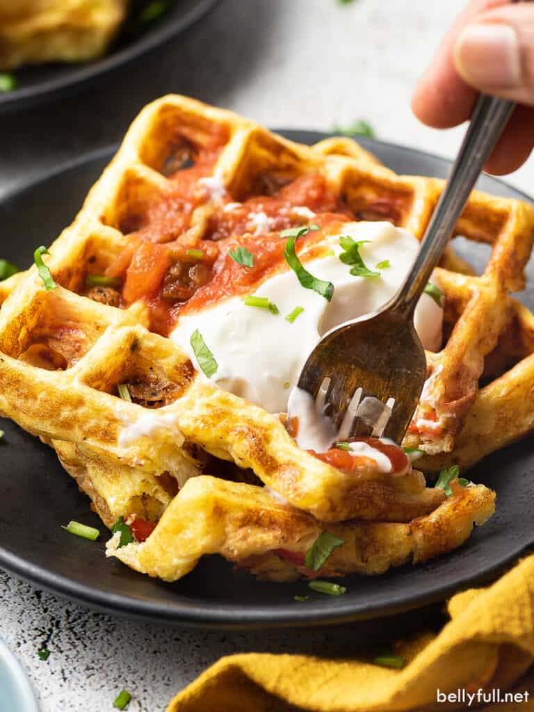 fork bite of cheese and egg waffles