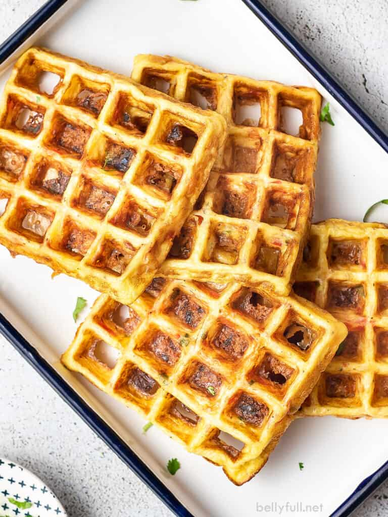 4 cheese and egg waffles on white serving tray