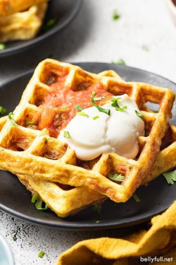 2 stacked chaffles with sour cream and salsa