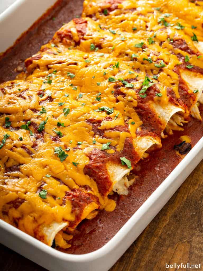baked cheesy chicken enchiladas in baking dish
