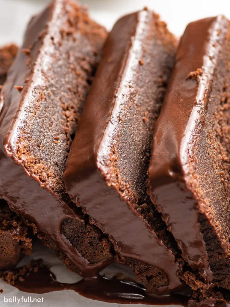 close up slices of glazed chocolate pound cake