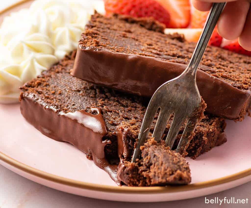 sliced chocolate cake with bite on fork
