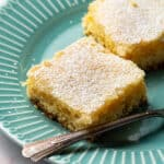 Two squares of Paula Deen gooey butter cake on a plate