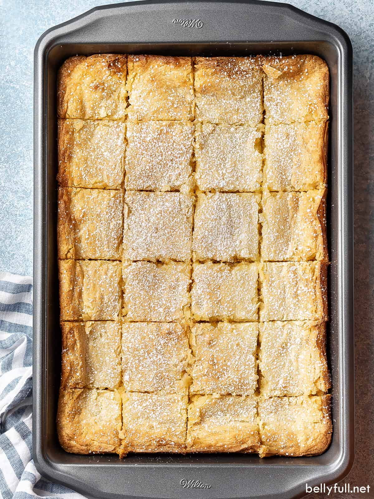 Overhead view of ooey gooey butter cake in a pan