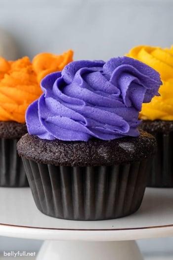 Front view of 3 Hocus Pocus cupcakes