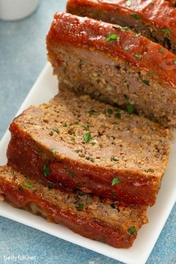 sliced glazed meatloaf on white serving plate