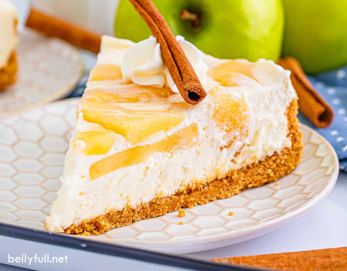A slice of no bake apple cheesecake on a plate
