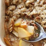 close up portion of baked pear crisp on spoon