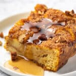 square piece of french toast casserole with syrup on plate