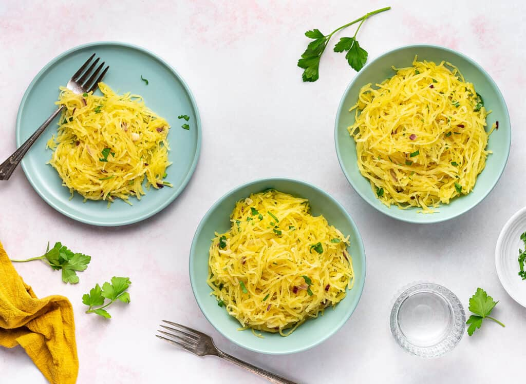 3 bowls willed with spaghetti squash