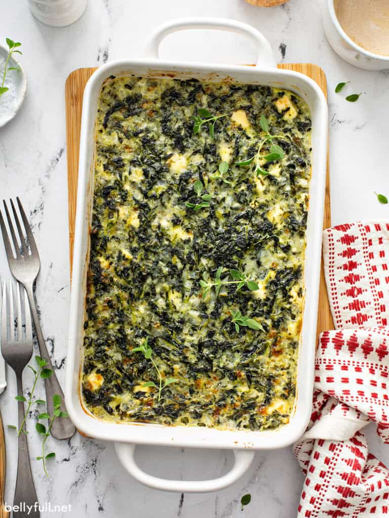 baked spinach casserole in white dish