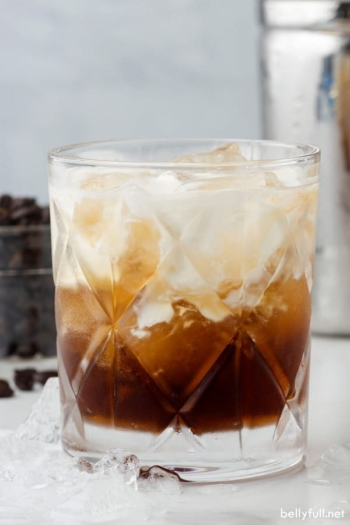 A slightly swirled white russian cocktail