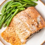 crab stuffed salmon fillet on plate with green beans