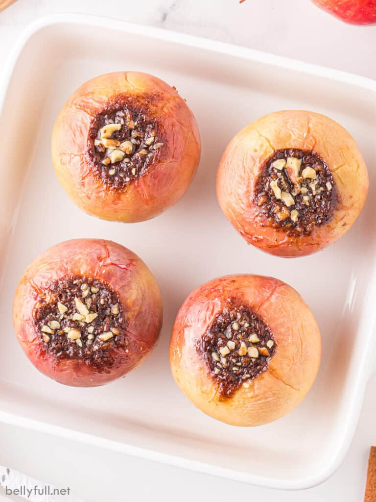 4 baked apples in square baking dish