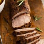 sliced roast pork tenderloin with fresh rosemary